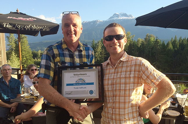 Revelstoke Community Futures had a great year approving 18 loans worth $1,187,000, Chairman John Simm (right) said in its annual report for 2015. He also honoured board member Todd Arthurs with a Volunteer of the Year award on Tuesdayt evening for all his many years of dedication as a director and then on our loans committee. Photo courtesy of Revelstoke Community Futures Development Corporation