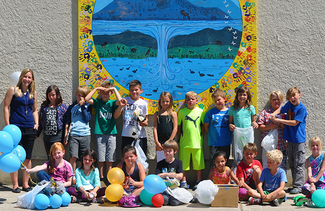 Teacher Stephanie Noel poses with her budding young scientists after the Great Egg Drop. David F. Rooney photo