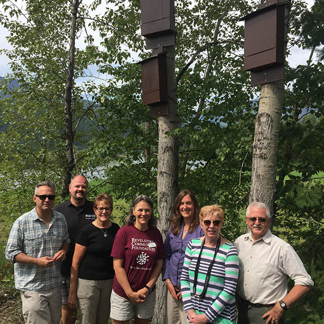 The Illecillewaet Greenbelt Society recently installed a dozen bat houses to provide shelter for the tiny flying mammals in the 22-acre woodland preserve along the north bank of the river. They were constructed at the Visual Arts Centre's community woodworking shop by Ken Talbot and Marc Paradis (unfortunately not present for this Wednesday, June 8 photo opportunity) and installed by Ward Kemerer and Greenbelt Director Wayne Martin and Adam Cruxhall of BC Hydro (not present). A number of organizations contributed to this project, including BC Hydro (represented by Jennifer Walker-Larsen), the Community Foundation (represented here by Zofie Humphreys) and the Revelstoke Credit Union (represented by Todd Weber). The Kootenay Bat Project was also a major contributor (although it was not represented at this photo opportunity). Greenbelt Director Barb Kemerer and Greenbelt Chairwoman Louisa Fleming are also in this photo David F. Rooney photo