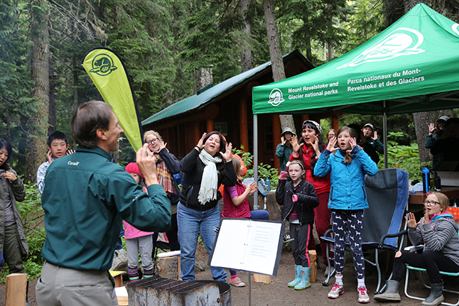 Learn-to Camp participants learned about the history of Rogers Pass through campfire songs and storytelling. Parks Canada photo
