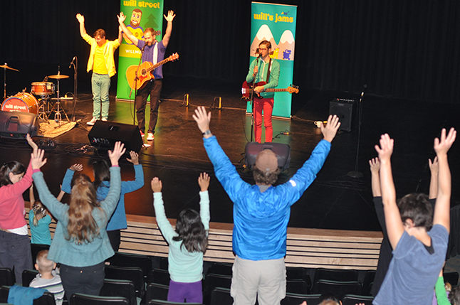 Popular children's musician Will Stroet (center) and his bandmates, Kevin Romain on drums and Elliot Langford on bass, gut the kids jumping and waving their arms during their energetic and very entertaining concert. David F. Rooney photo