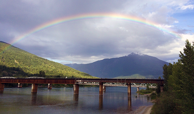 "Sue Leach snapped this early evening rainbow on Wednesday. ""I took pics of the double rainbow yesterday, too,"" she told The Current. ""I just thought it looked so special over Revelstoke."" Please click on the image to see a larger version. Sue Leach photo"