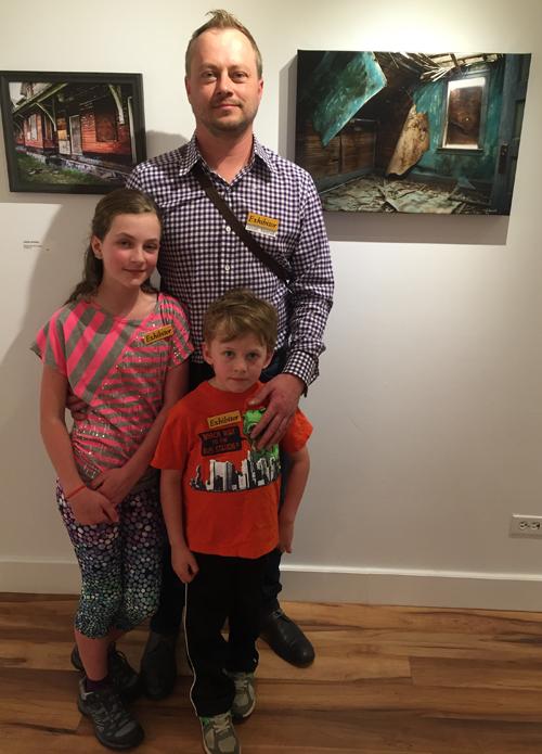 Photographer Jason Keerak poses with his children Ava and Ivo at the opening of his show, Abandoned. This is an excellent and intriguing selection of images taken of abandoned houses in Saskatchewan. While most of the photos are his, Ava and Ivo have their own entries which just goes to show that the apple doesn't fall far from the tree. David F. Rooney photo