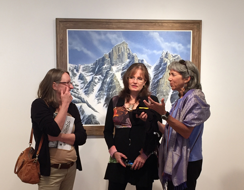Painter Valerie Rogers (center) talks about her work with local art lovers. David F. Rooney photo