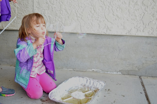 One kindergarten class was outside blowing bubbles from dish soap on water. This taught them about iridescence.