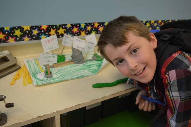 Grade four student Austin Keetley was keen to show a clay model of nuclear power that he had made himself. The model shows how nuclear power would be made.