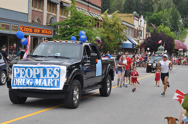 The friendly foks at Peoples' Drug Mart march in the parade. David F. Rooney photo