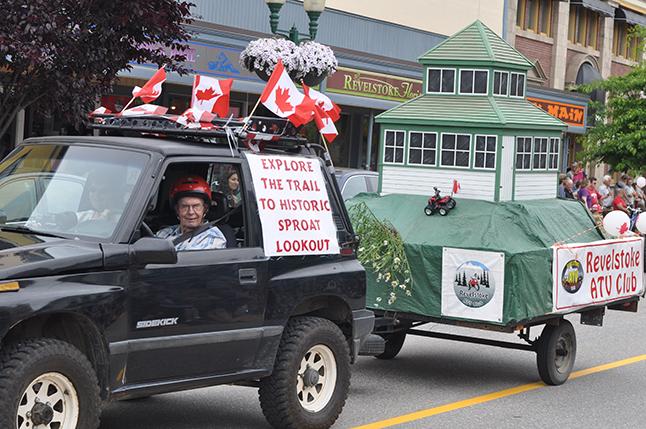 Ed and Moira Jaateenmaki drove the ATV Society's float on Friday. David F. Rooney photo