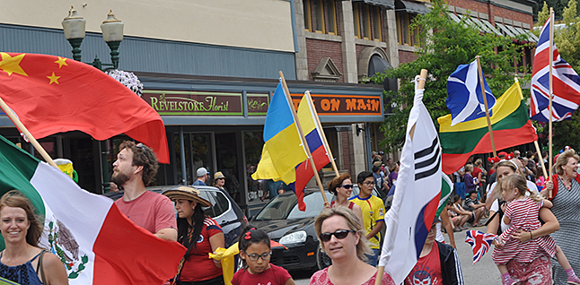 The flags carried by Multicultural Society members represent nationalities that are represented in our city. David F. Rooney photo