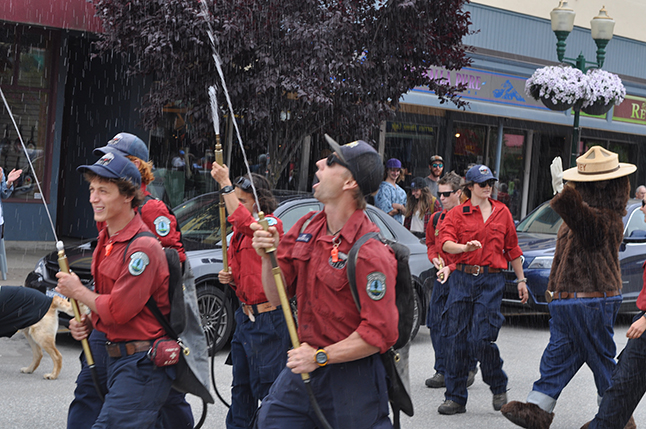 Here come the Ministry of Forests fire crew, obviously prepared to help parade-watchers cool off. David F. Rooney photo