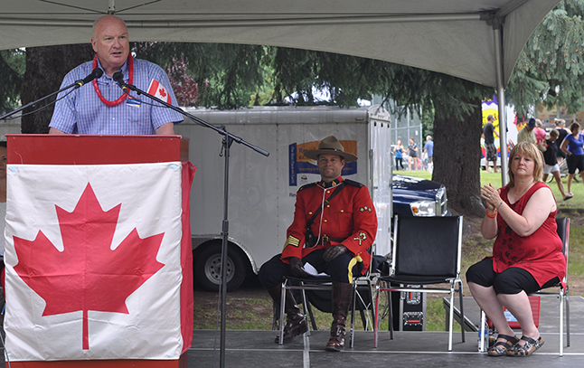 Mayor Mark McKee addresses the crowd at the Birthday Party at Queen Elizabeth Park. Revelstoke has accomplshed a lot in recent years and looks set to achieve even more in the years ahead. David F. Rooney photo