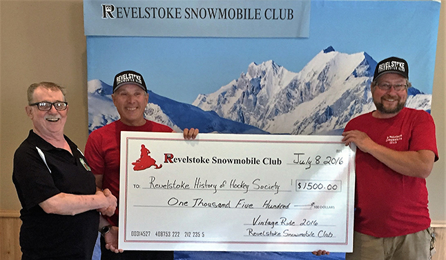 """Revelstoke Snowmobile Club Vintage Ride Coordinator Dusty Dancer (center) and RSC Director Clayton Berlingette (right) were pleased to present the proceeds of the club's annual Vintage Snowmobile Ride to Dennis Beraducci (left) from the History of Hockey Society. The club chose History of Hockey because of its outstanding work with the kids in Minor Hockey. The presentation was made on July 8 at the new Snowmobile Club Welcome Center off Westsude Road. The club wanted to show support for the community that shows so much support for them. """"Just a little pay it forward,"""" Dusty said. Dennis Beraducci told the people in attendance that this donation """"should help at least three or four kids join Minor Hockey who financially would not have been able to."""" Photo courtesy of Kathy Mower Berlingette/Revelstoke Snowmobile Club"""