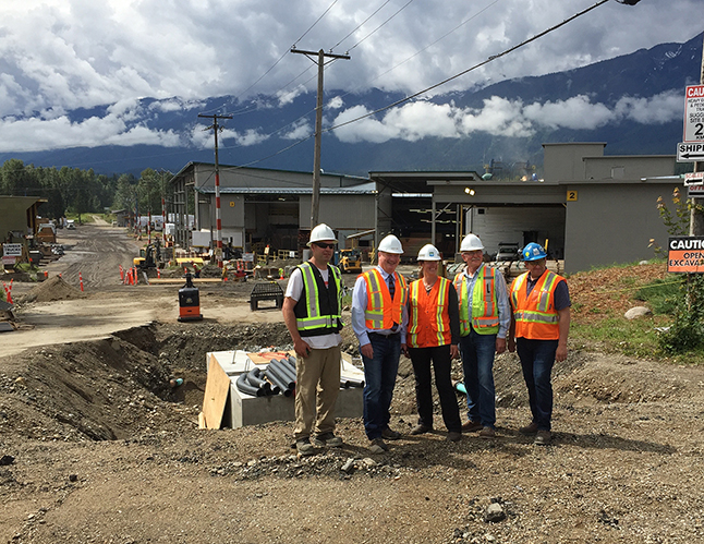BC Hydro has been busy lately burying its overhead cables at Downie. That's meant closing that entrance to the mill forcing a couple of detours that have apparently mystified some drivers on Fourth Street East. The $1 million project should be completed soon. In the meantime, Mayor Mark McKee (second from the left) joined Hydro Community Liaison Jennifer Walker-Larsen (center) and Mill General Manager Alan Smyth (second from the right) with Ted Allain, Downie's electrical projects' manager, and Hydro project foreman Asa Lishman.. David F. Rooney photo