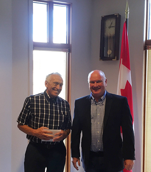 Retired physician and former mayor Geoff Battersby and Mayor Mark McKee pose for the cameras after Battersby was presented with a letter from Council congratulating him on his recent appointment to the Order of Canada — the country's highest honour for a civilian. Click on the YouTube player below to watch the presentation conducted at the start of the regular Council meeting held on Tuesday, August 9. David F. Rooney photo