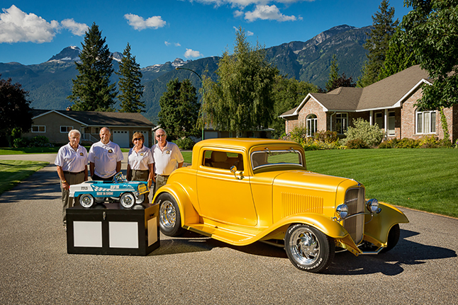 """John Scarcelli Jr and John Scarcelli Sr pose with Jo and Don Hawker with the Hawkers' award-winning 1932 Ford and the Best-in-Show trophy it picked up at the recent Hot Nite in Kamloops car show. """"The Scarcellis helped me build the car from start to finish which was two years,"""" Don told The Current. He said the golden won Best in Show out of 541 cars. It has won awards at other shows but this was its highest — so far. Plese click on the photoi to see a larger version of it. Bob Bittner photo"""