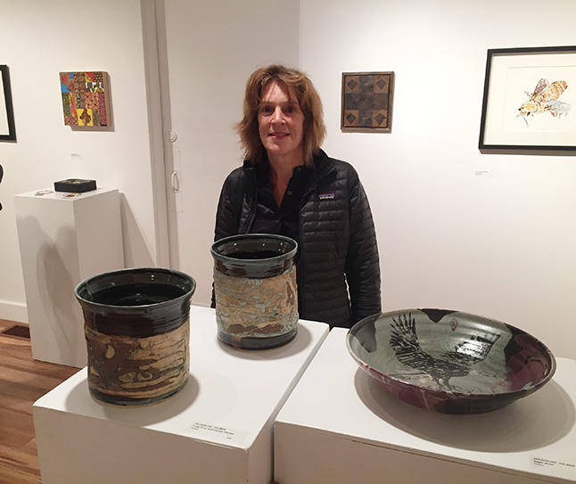 Jacquie Palmer poses with her three large pottery offerings. David F. Rooney photo