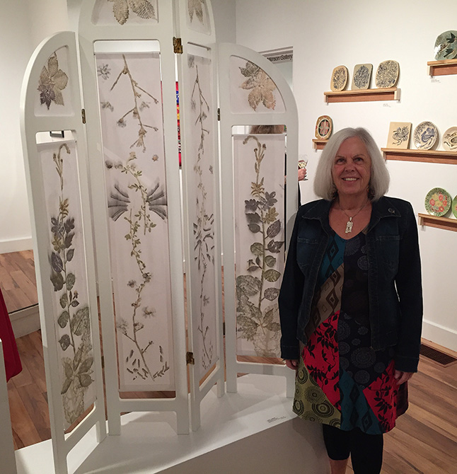 Akira Hansen poses beside her lovely fabric screen, entitled Homage to Frances. David F. Rooney photo