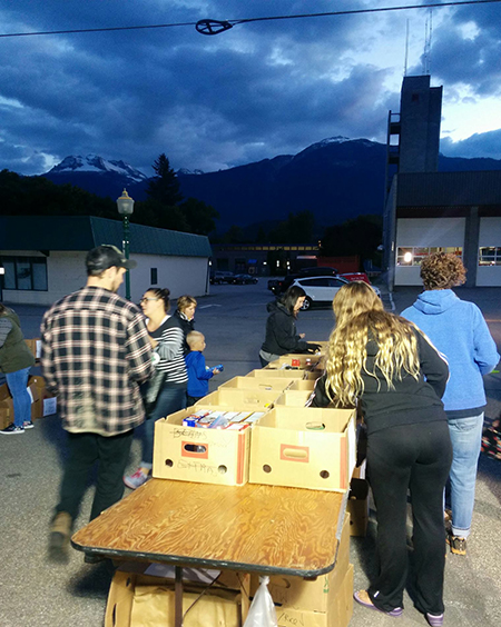 As the light fades, volunteers were still busy sorting and packing the foods donated by generous Revelstokians to the Emergency Services Food Drive on Wednesday evening. Lisa Moore photo