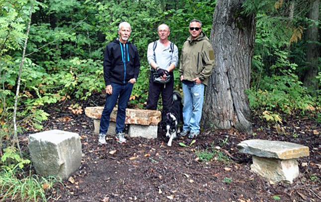 Illecillewaet Greenbelt Society directors Don Pegues, Kevin Weese and Wayne Martin pose with cluster of stones seats created for tired joggers or hikers in the Greenbelt Saturday, September 3. The society  manages the 22-acre Greenbelt along the Illecillewaet River. Not present for the ohoto: Louisa Fleming, Toni Johnston and David Rooney. Barb Kemerer photo
