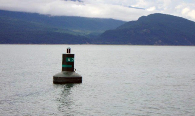 """Who says you can't get things done? Peter Bernacki and his friends are proof that if you complain loudly enough you can, in fact, even reverse decisions made by the federal bureaucracy.  Take this buoy at the entrance to Beaton Arm in Upper Arrow Lake, which had been slated for removal. """"We have received numerous communications from members of the public regarding this aid to navigation all of which refer to the necessity of keeping the buoy in place,"""" Glenna Evans, acting superintendent of the Aids to Navigation & Waterways Canadian Coast Guard Western Region, told him in a recent e-mail. """"I would like to advise that it is our intention to have (the) buoy replaced in its advertised position at some point in late July early August of this year, depending the availability of the contractor being employed to replace the buoy and the necessary CCG personnel to complete the position verification process."""" The Coast Guard did replace it. According to the Canadian Hydrographic Chart it is Chart 3057B SHOREHOLME TO/À ARROWHEAD. It is in 43.5 feet of water and is anchored by 100 feet of chain to a one ton concrete anchor. Position in degrees minutes and seconds, NAD 83: Lat: 50° 40' 22.195"""" N Long: 117° 54' 31.121"""" W. That same position in decimals: NAD 83 Lat: 50 40.3699' N, Long: 117 54.5172' W. The buoy itself is a Tideland SB-98 Green, with a Carmanah 860 Green light. Photo courtesy of the Canadian Coast Guard"""