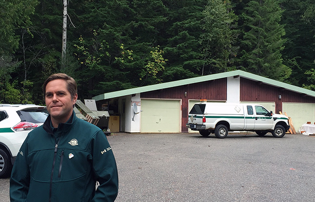 Nick Irving, superintendent of Mount Revelstoke and Glacier National Parks, says Parks Canada plans to build a first-ever frontcountry campsite at the site of the old staff residences, which includes this vehicle garage near the start of the Meadows-in-the-Sky Parkway. Parks Canada is planning to spend $4.5 million on the project. All told, Parks plans a 50-unit campground offering sites for tents, trailers, campers and motorhomes. The old superintendent's house — which is the only remaining house left at the site — may be refurbished as a campers' centre. The federal government is also planning to spend $1.5 million on upgrades to the Rogers Pass Maintenance Compound in Glacier National Park, he said. David F. Rooney photo