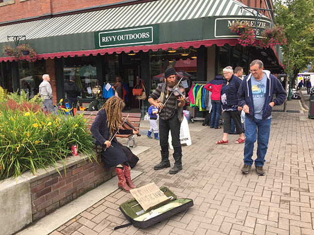 These energetic buskers provided a musical background to the street sale and Farmers' Market to the delight of passersby. David F. Rooney photo
