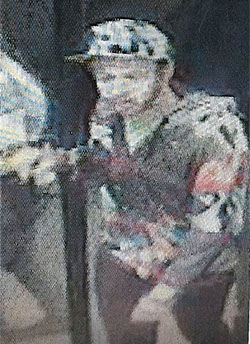 """Revelstoke RCMP are requesting the public's assistance in identifying the following man. On Sunday, September 25, at 2:28 am a white male between 25 and 30 years of age, approximately 5'7"""" inches tall with facial hair and wearing a cap, and a multi-colored jacket, is suspected of taking several items off the shelf from the 7-11 Convenience Store on Victoria Road in Revelstoke without making any effort to pay for these items. If you have any information with respect to this theft or any other criminal act, please contact the Revelstoke RCMP at 250-837-5255 or Crime Stoppers at 1-800-222-8477 or visit their website at www.revelstokecrimestoppers.ca. Photo courtesy of the Revelstoke RCMP"""