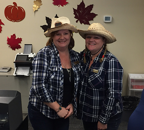 Victoria Mendons (left) and Keri Miskamin were happy little cowgirls at the Royal Bank. David F. Rooney photo