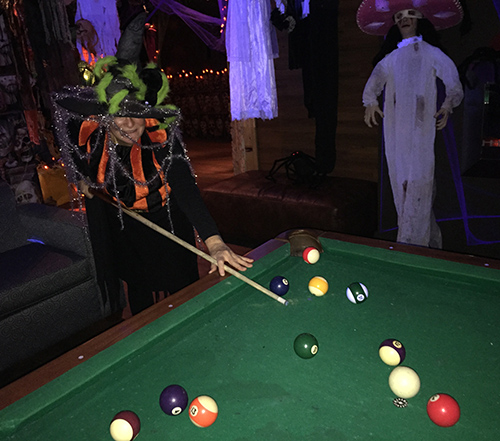 Ginger Shoji played a frightening game of pool at Team Gloria's annual Halloween Party at the Traverse on Friday night. David F. Rooney photo