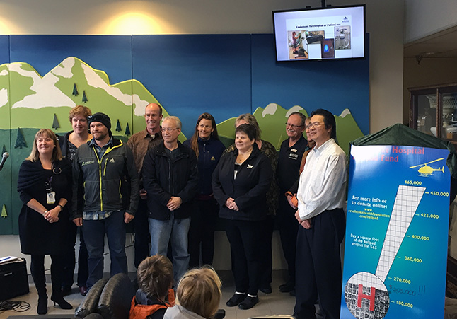 QVH Manager Julie Lowes (left) and Steven Hui (right) pose with representatives of the groups and businesses that made donations. Not everyone who donated was necessarily present at the campaign launch. David F. Rooney photo