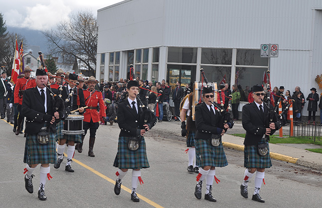 Revelstokians turned out by the hundreds to honour the Canadians who died in two world wars, Korea and Afghanistan. The parade was led by the Revelstoke Pipe Band. David F. Rooney photo