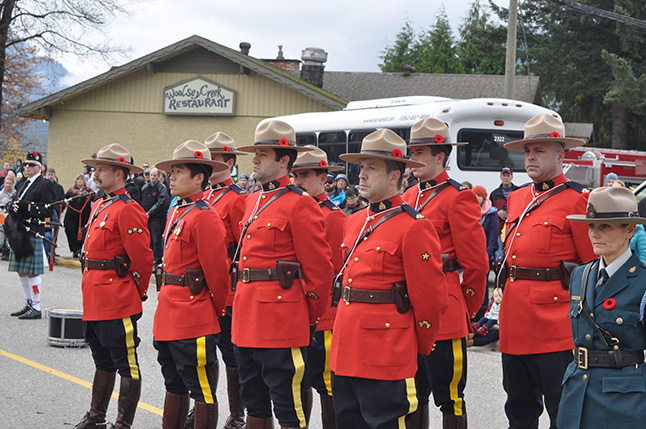 The Mounties red serge uniforms provided a burst of colour to the otherwise-grey day. David F. Rooney photo