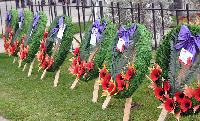 Wreaths await the human hands that will place them at hr foot of the cenotaph. David F. Rooney photo
