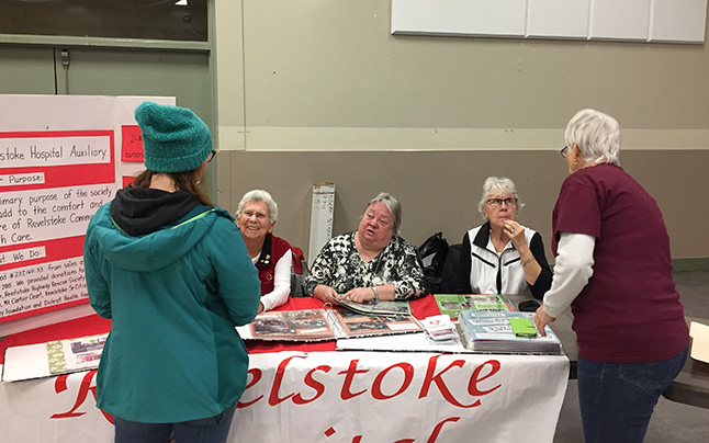 The Revelstoke Hospital Auxiliary table was busy! David F. Rooney photo