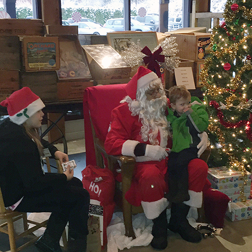 Ssnta Claus did his thing with young children, aided by an elf. David F. Rooney photo