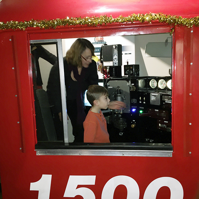 And here is a young boy who is obviously quite taken by the simulator. David F. Rooney photo