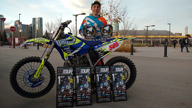 Seth Chevrier poses with his bike and some of his awards. Photo curtesy of Joel Chevrier